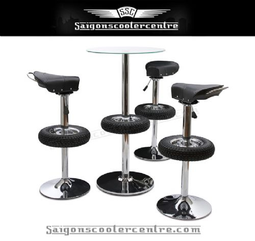 "Fully chromed stunning 4 piece set. Includes 3 adjustable bar stools with old school Vespa saddle seats and 1 glass top table. Based on 8"" VBB wheel design."