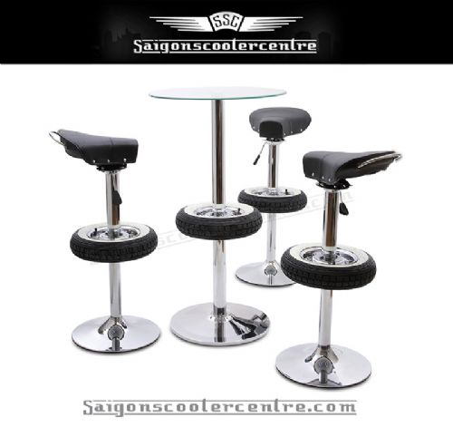 "Fully chromed stunning 4 piece set. Includes 3 adjustable bar stools with old school Vespa saddle seats and 1 glass top table. Based on 8"" VBB wheel design.   White wall tyre design.  Depend on the manufacturer used. Samples shown are Continentals."